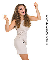 Happy young woman in dress dancing