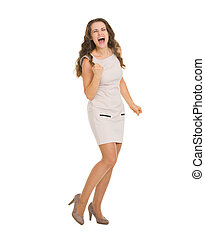 Happy young woman in dress rejoicing success