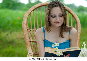 Happy young woman in garden chair - Happy young woman in...