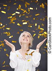 Happy Young Woman In Golden Rain