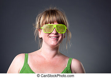 Happy young woman in green glasses
