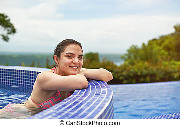Happy young woman in jacuzzi