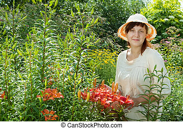 Happy young woman in lily plant