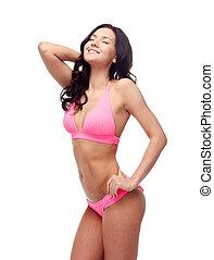 happy young woman in pink bikini swimsuit - people, fashion,...