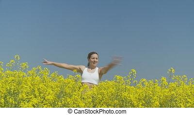 happy young woman in rape field