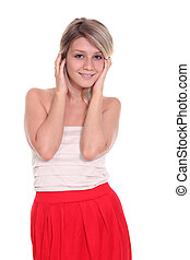 Happy young woman in red dress.