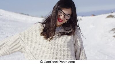 Happy young woman in snowy landscape