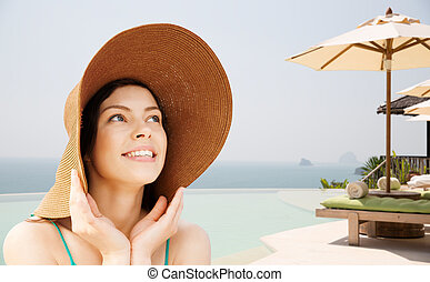 happy young woman in straw hat on tropical beach