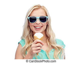 happy young woman in sunglasses eating ice cream