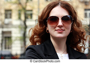 Happy young woman in sunglasses