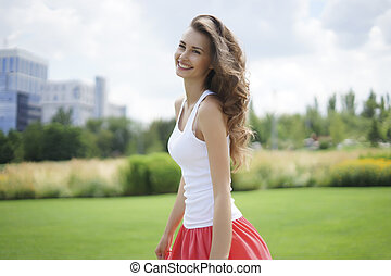 Happy young woman in the park