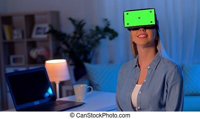 happy young woman in vr glasses at home at night -...