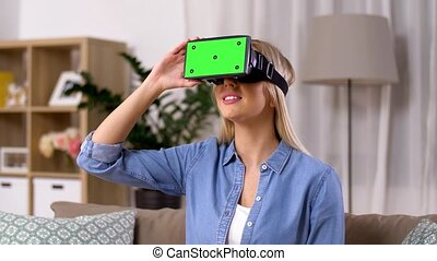 happy young woman in vr glasses at home - technology,...