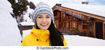 happy young woman in winter clothes outdoors - winter,...