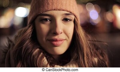 happy young woman in winter hat at christmas