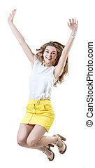 Happy young woman in yellow skirt jumps up.