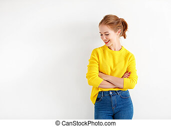 happy young woman in yellow sweater on white background