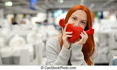 Happy young woman is standing in a shopping mall - Happy...