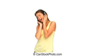 Happy young woman listening to musi