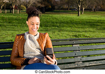 happy young woman looks at her engagement ring.