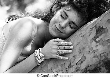 happy young woman loving nature hug a tree bw