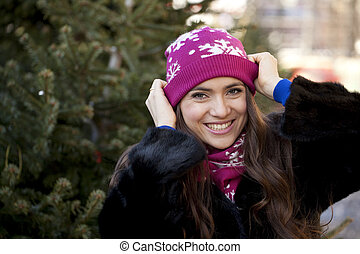 Happy young woman on a background of a winter city