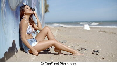 Happy young woman on a tropical beach