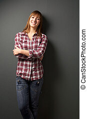 Happy young woman on gray background