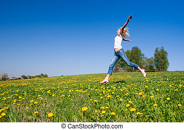 happy young woman on meadow - young female having fun on...