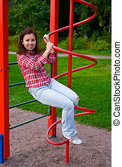 happy young woman on playground