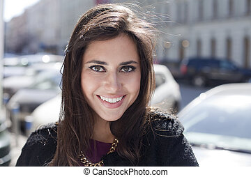 Happy young woman on the street