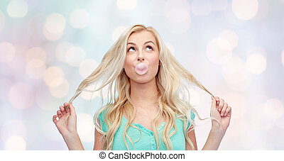 happy young woman or teenage girl chewing gum - emotions,...