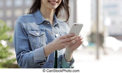 happy young woman or teenage girl with smartphone - ...