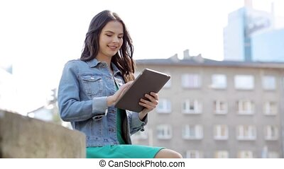 happy young woman or teenage girl with tablet pc