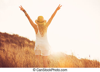 Happy Young Woman Outdoors at Susnet. Fashion Lifestyle. - ...