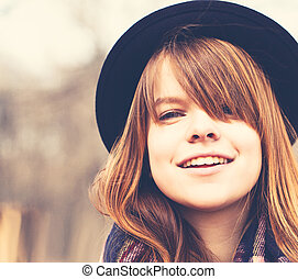 Happy Young Woman Outdoors. Lifestyle Closeup Portrait