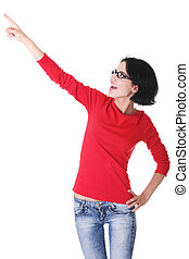 Happy young woman pointing on copy space
