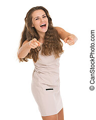 Happy young woman pointing on in camera