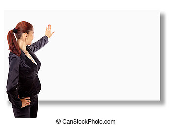 Happy young woman pointing upwards