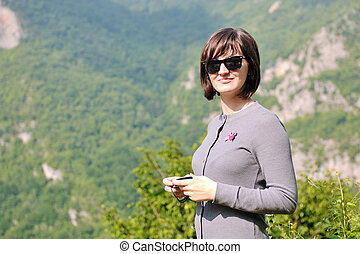 happy young woman portrait in nature