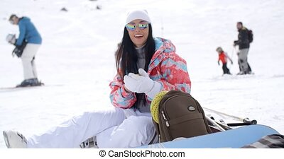 Happy young woman posing for a selfie in the snow