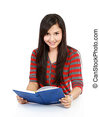 Happy young woman reading book in isolated background