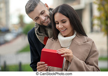 Happy young woman receiving a love letter