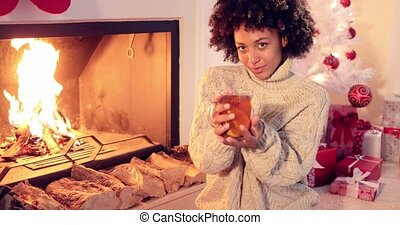 Happy young woman relaxing at Christmas