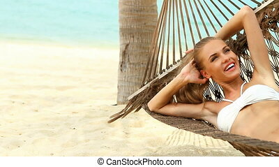 Happy young woman relaxing in a ham - Attractive woman...
