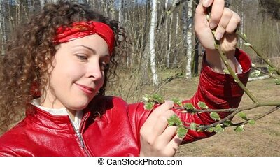 woman review branch with leaf buds - happy young woman...