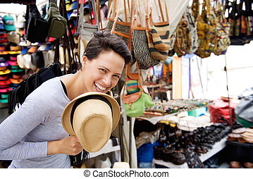Happy young woman shopping at market