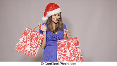 Happy young woman shopping for Christmas gifts