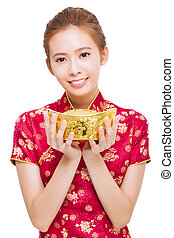 happy young woman showing gold for chinese new year
