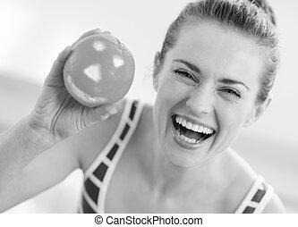 happy young woman showing halloween orange